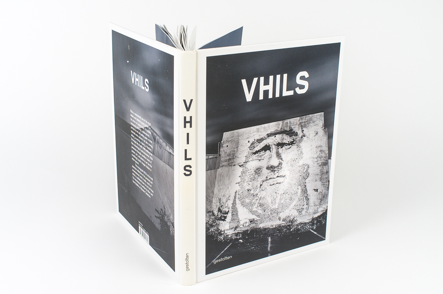"Book cover for ""Vhils"", a collection of work from the german street artist. Published on Gestalten Verlag (Hamburg), 2011"