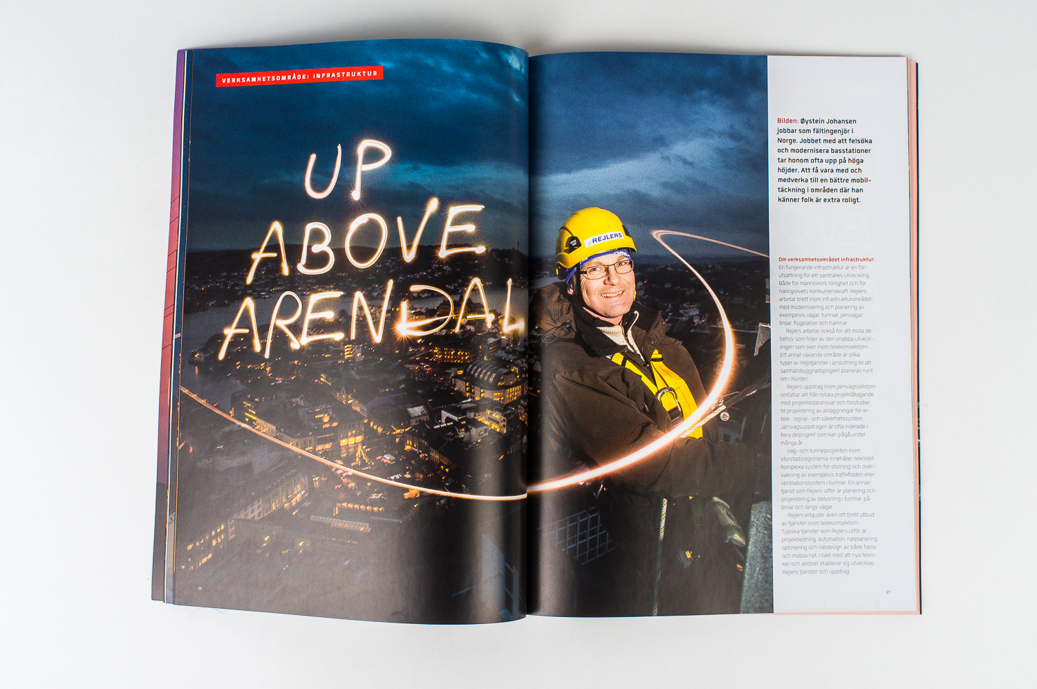 From Rejlers ABs annual review, 2013. Photo of telecom personel climbing a 70m mast overlooking the town of Arendal. Published in 2014 in swedish and english versions.
