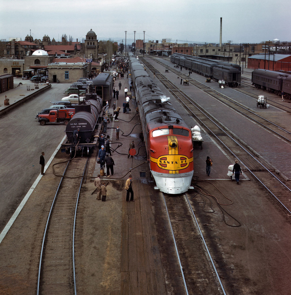 "Santa Fe R.R. streamliner, the ""Super Chief,"" being serviced at the depot, Albuquerque, New Mexico. March 1943. Taken by the collection of the Farm Security Administration - Office of War Information at the Library of Congress."